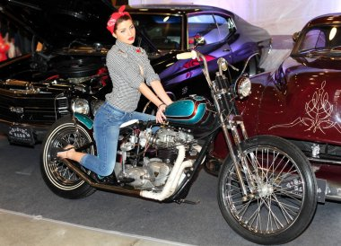 MOSCOW, RUSSIA, march 2013, 10th International Motorcycle Exhibition MOTOPARK, Beautiful girl on motorcycle
