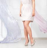 Photo Beautiful woman leg and flying silk