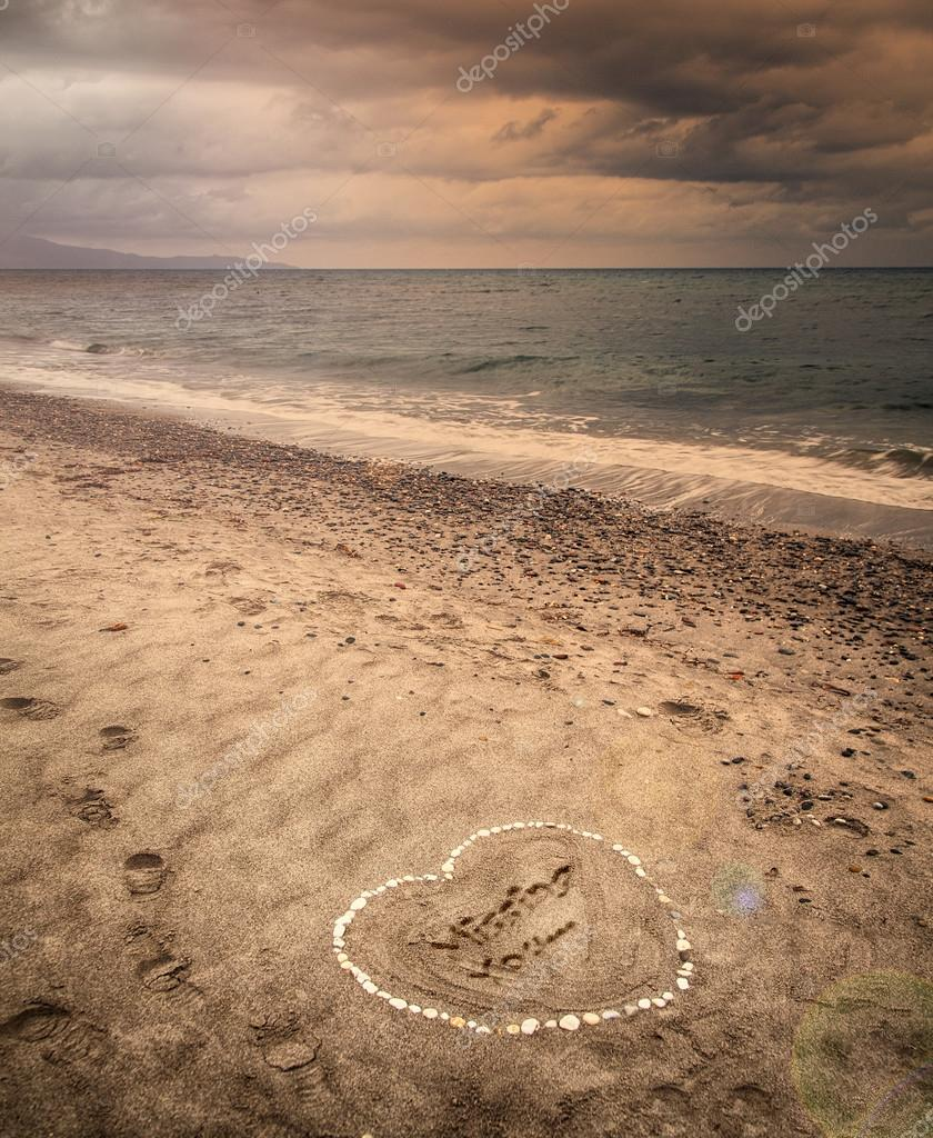Message of a missing love in the sand