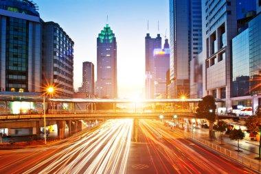 Moving car with blur light through city