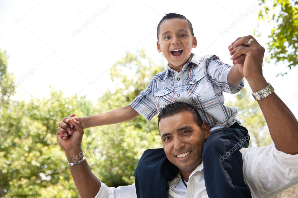 Hispanic Father and Son Having Fun Together in the Park. stock vector