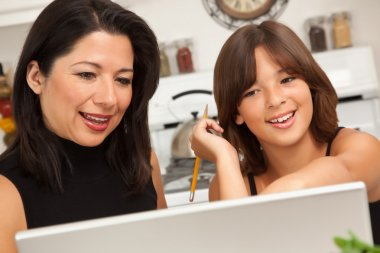 Hispanic Mother and Mixed Race Daughter on the Laptop