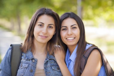 Young Adult Mixed Race Twin Sisters Portrait Outside