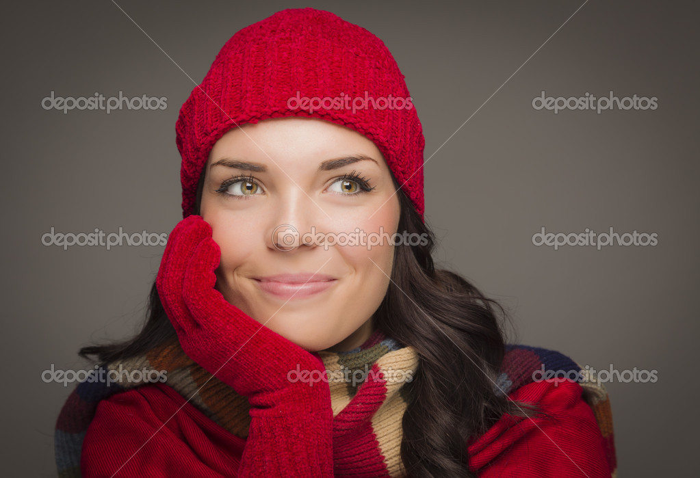 Mixed Race Woman Wearing Mittens Looks to Side