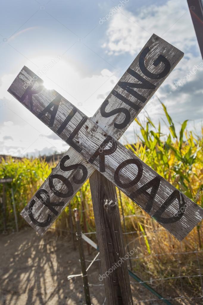 Antique Country Rail Road Crossing Sign Near a Corn Fiel