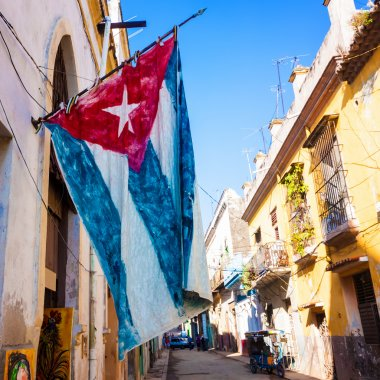 Street in Old Havana with a cuban flag