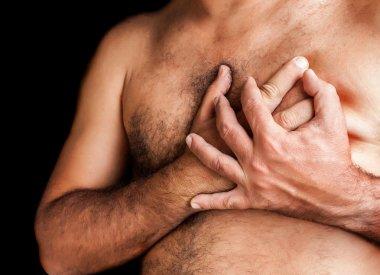 Shirtless man suffering a heart attack