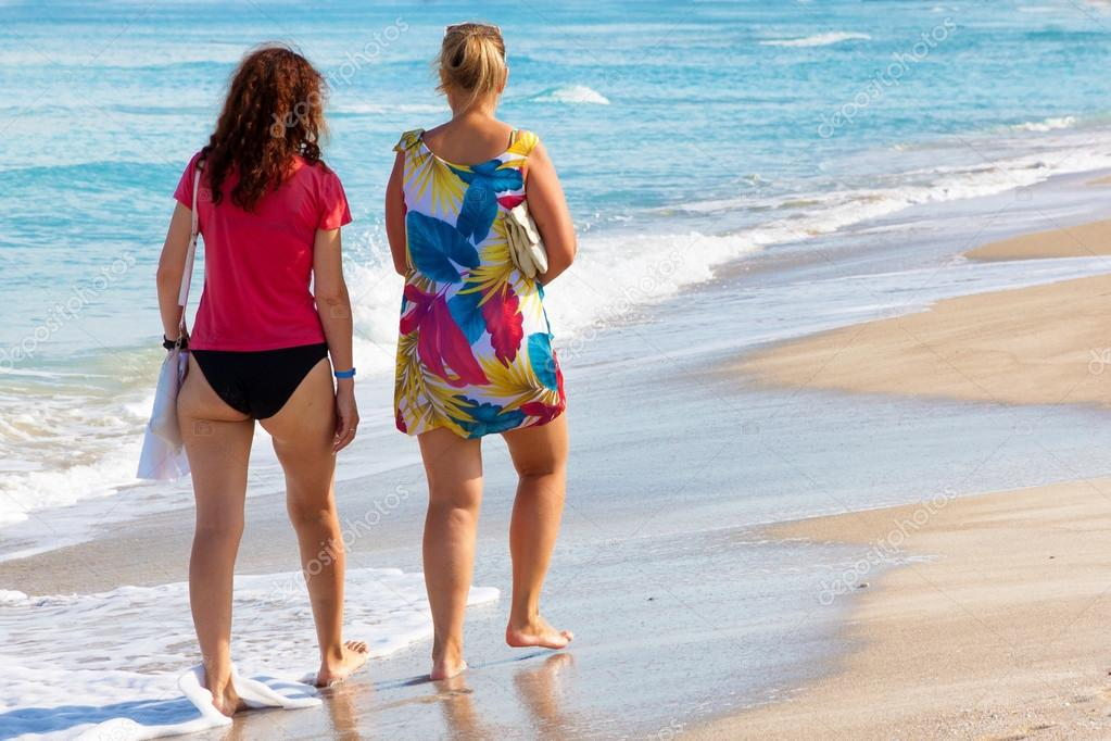 Girls Walking At The Beach Of Varadero In Cuba Stock Photo