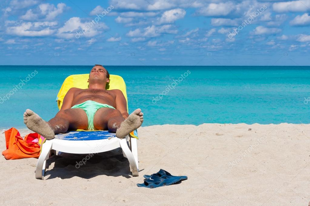 Young Man Sunbathing At The Beach Of Varadero In Cuba Stock Photo