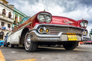 Low angle view of an old red Chevrolet in Havana