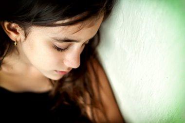 Emotional portrait of a sad girl