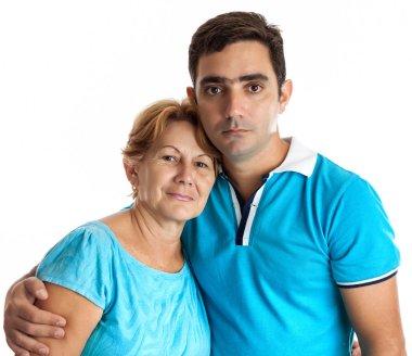 Hispanic man hugging his mother