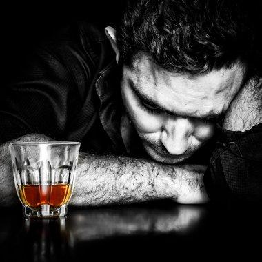 Dark portrait of a drunk man