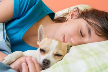 Girl sleeping with her dog