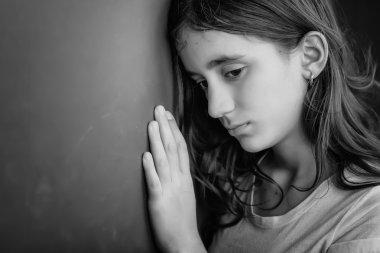 Grunge portrait of a sad girl