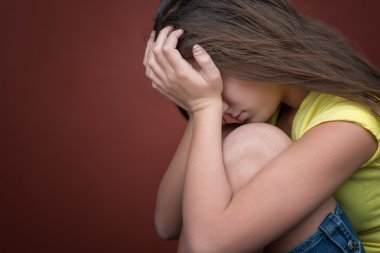 Sad teenage girl crying
