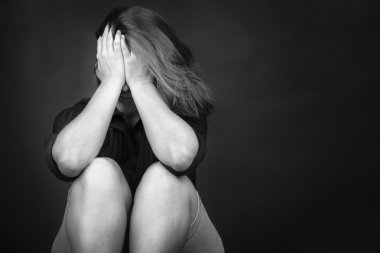 Young woman crying depression violence