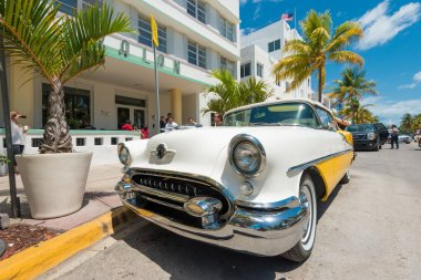 Vintage car parked at Ocean Drive in South Beach, Miami