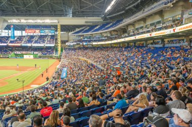 Fans watching a baseball game at the Miami Marlins Stadium