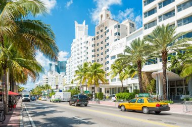 Famous art deco hotels and traffic  at Collins Avenue in Miami B