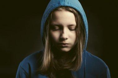 Sad teen girl in hood sitting with closed eyes stock vector
