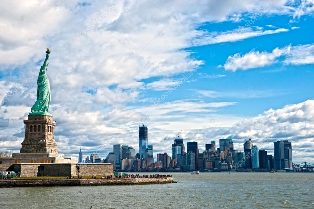The Statue of Liberty and Manhattan Skyline, New York City. USA.