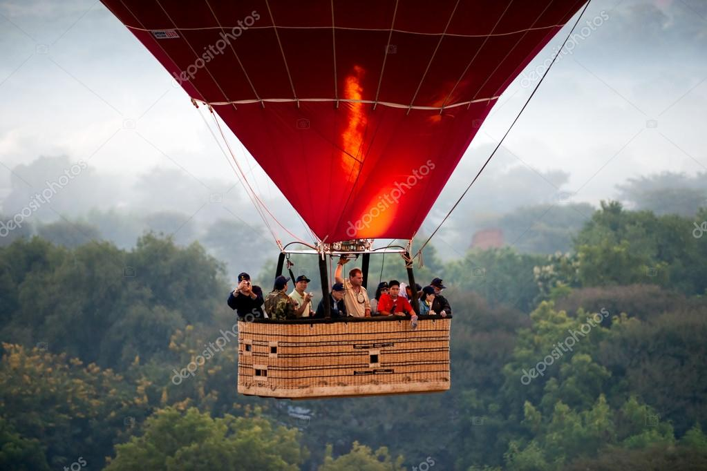 BAGAN - NOVEMBER 29,: Tourist in an Hot Air Balloon over the pla