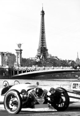 Vintage picture of Eiffel tower with old car on foreground