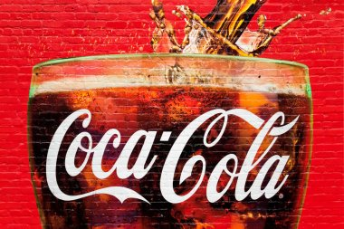A glass full of Coca Cola