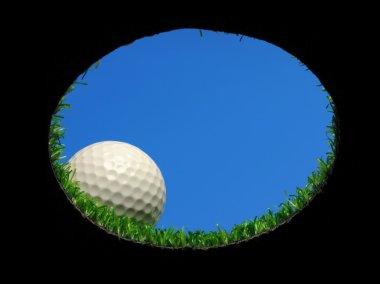 golf ball over hole