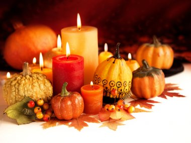 Candle and pumpkins
