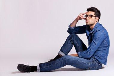 fashion man sitting and thinking