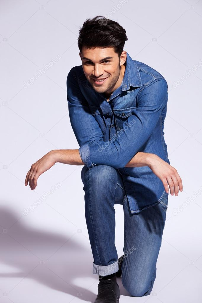 Man Poses On One Knee In Studio Stock Photo 169 Feedough
