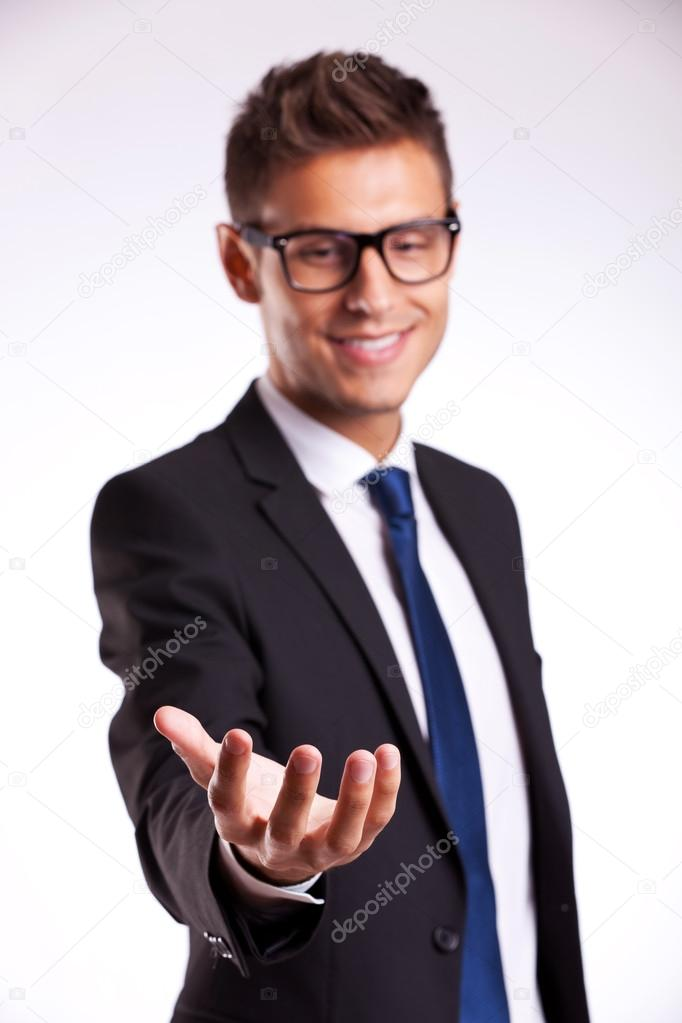 Technology Management Image: Business Man Holding Something On His Hand