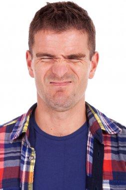 young man making a weird face