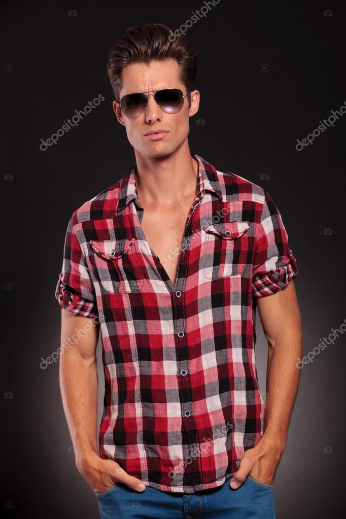 Fashion man wearing sunglasses with hands in pockets