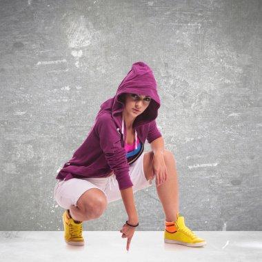 woman dancer wearing a hoodie