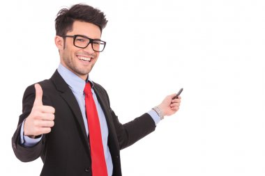 Business man shows thumbs up & points