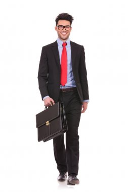 business man walks forward with suitcase