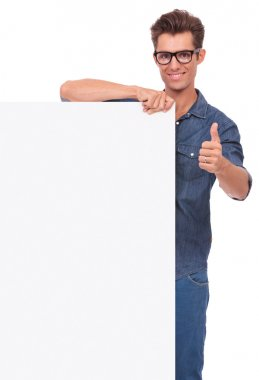 man with board & thumb up