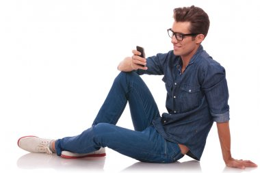 man on the floor texting