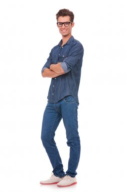trendy man standing with arms crossed