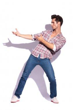 man holds imaginary gun