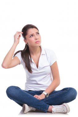 casual woman sits puzzled