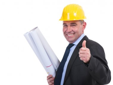 old engineer holds drafts and thumbs up