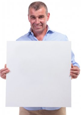 casual middle aged man holding banner