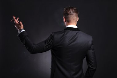 rear view of business man with cigar