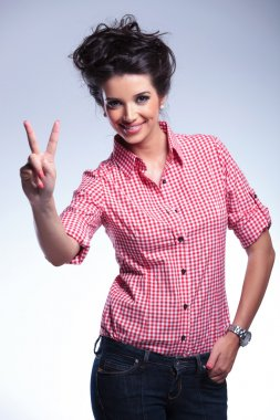 young casual woman making the victory sign