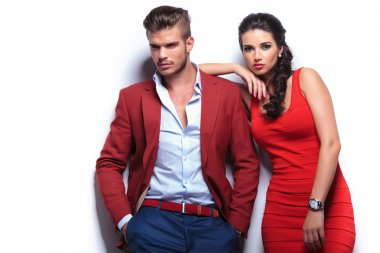 young fashion man and woman against white wall