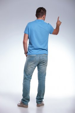 rear of a casual man pressing an imaginary button